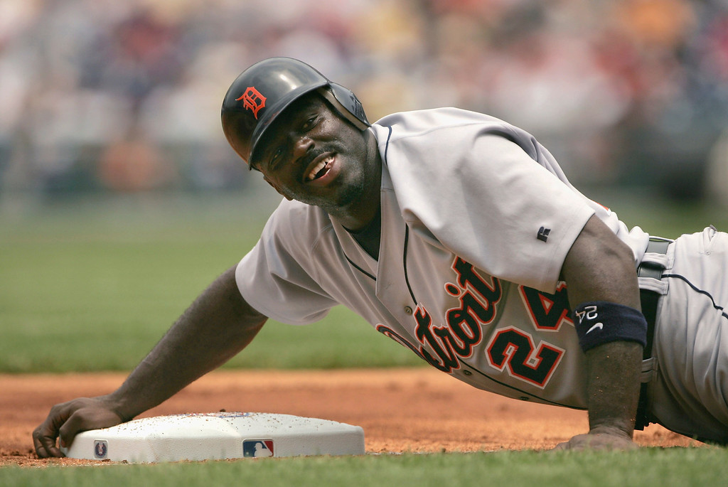 . RONDELL WHITE -- Rondell White #24 of the Detroit Tigers hangs onto the bag as he advanced to third base on a first-inning sacrifice fly by Carlos Guillen as the Philadelphia Phillies defeated the Tigers 6-2 during MLB interleague action at the Citizens Bank Park on June 17, 2004 in Philadelphia, Pennsylvania. (Photo by Doug Pensinger/Getty Images)