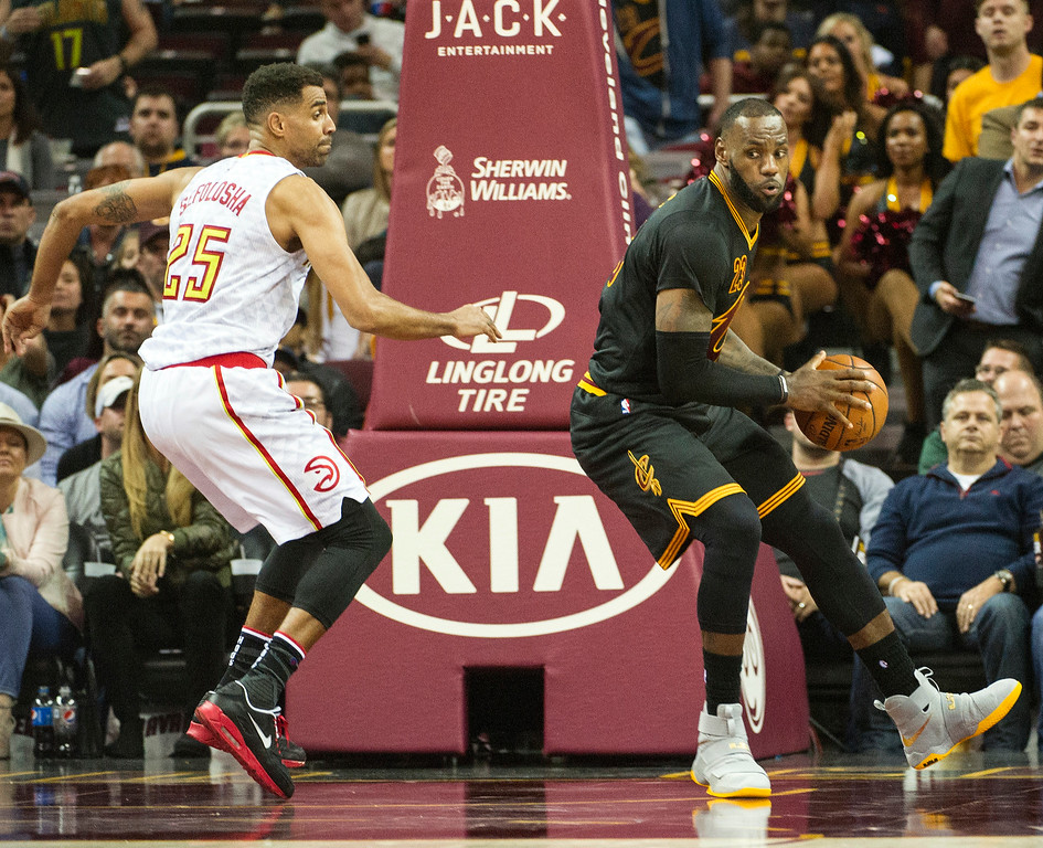 . Cleveland Cavaliers\' LeBron James, right, spins towards the basket as Atlanta Hawks\' Thabo Sefolosha (25) defends during the second half of an NBA basketball game in Cleveland, Tuesday, Nov. 8, 2016. The Hawks won 110-106. (AP Photo/Phil Long)