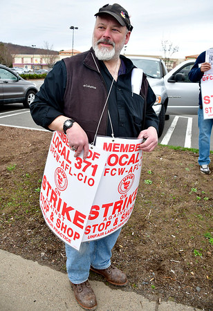 4/11/2019 Mike Orazzi | Staff Striking Stop & Shop worker Ted Bouchard at the grocery store on Route 6 in Bristol on Thursday.