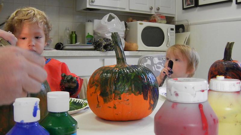 DSCN1048 - Ada and Dylan painting pumpkins.MOV