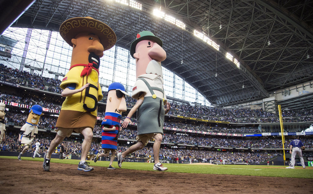 . The racing sausages sprint to the finish line in the sixth inning of the Milwaukee Brewers and Colorado Rockies game on opening day at Miller Park on April 1, 2013 in Milwaukee, Wisconsin.  (Photo by Tom Lynn/Getty Images)