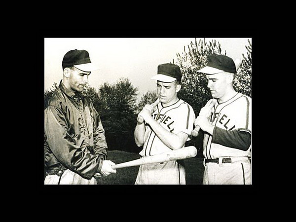 Good photo for Janice Beetle history of athletics article:   Bud Hagan, left, the first athletics director at Westfield State, goes over batting tips with some of his players circa 1957.