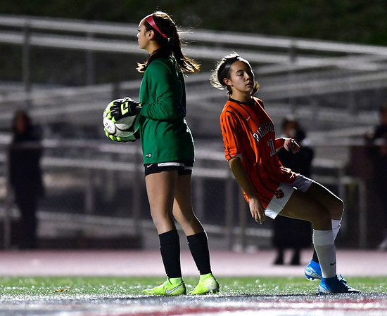 11/19/2019 Mike Orazzi | Staff Southington High School's Emily Eigo (1) and Ridgefield High School's Julia Bragg (20) during the Class LL Semifinal Girls Soccer match at Naugatuck High School Tuesday night. Southington advanced to the final 1-0.
