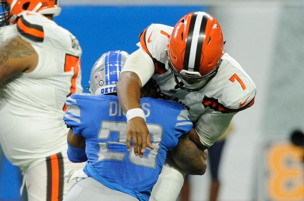 . Detroit Lions cornerback Quandre Diggs (28) hits Cleveland Browns quarterback DeShone Kizer (7) during the second half of an NFL football game, Sunday, Nov. 12, 2017, in Detroit. Kizer left the game after the hit. (AP Photo/Jose Juarez)