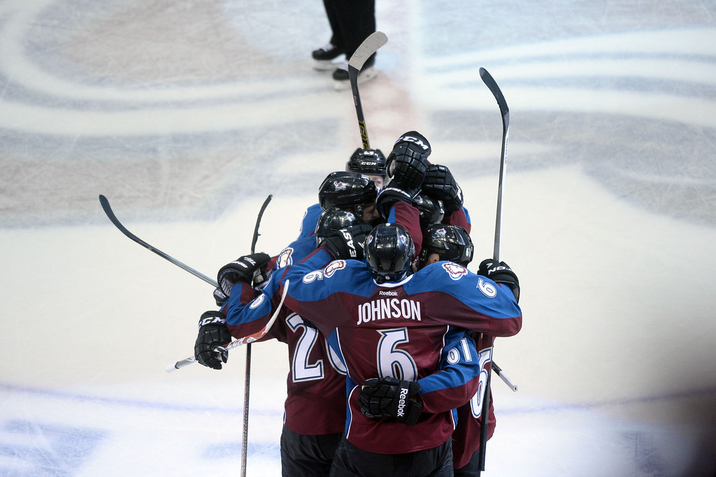 . DENVER, CO - APRIL 26: P.A. Parenteau (15) of the Colorado Avalanche celebrates his game-tying 3-3 goal agains the Minnesota Wild with teammates during the third period. The Colorado Avalanche hosted the Minnesota Wild during game five of the first round of the NHL Stanley Cup Playoffs at the Pepsi Center on Saturday, April 26, 2014. (Photo by Karl Gehring/The Denver Post)