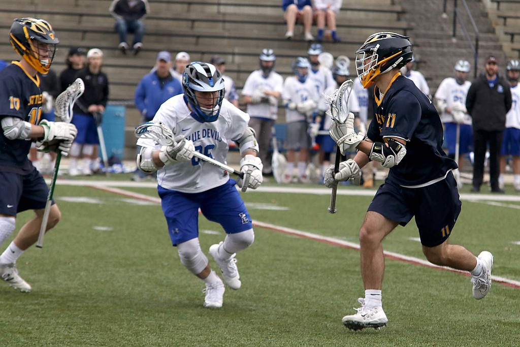. Leominster High School boys lacrosse played Littleton High School today at Doyle Field in Leominster. Leominster\'s Jack Cordio covers Littleton\'s Brody Leinson as he takes off down field with the ball. SENTINEL & ENTERPRISE/JOHN LOVE