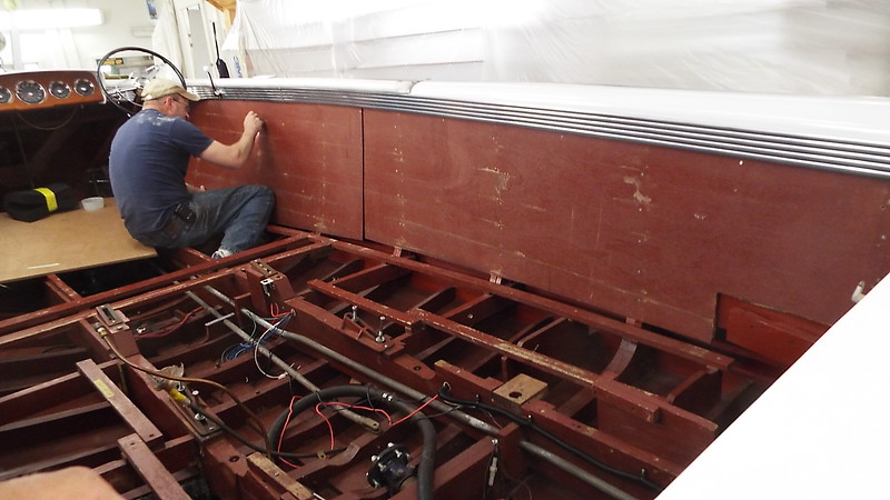 Another view of the backer being installed.