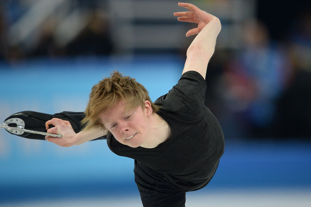 . Canada\'s Kevin Reynolds performs during the Men\'s Figure Skating Short Program at the Iceberg Skating Palace during the Sochi Winter Olympics on February 13, 2014.  YURI KADOBNOV/AFP/Getty Images