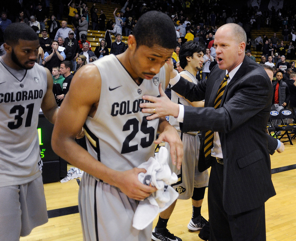 . BOULDER, CO. - MARCH 7: Colorado coach Tad Boyle congratulated guard Spencer Dinwiddie after the win. The University of Colorado men\'s basketball team defeated Oregon 76-53 Thursday night, March 7, 2013 at the CU Events Center in Boulder. (Photo By Karl Gehring/The Denver Post)
