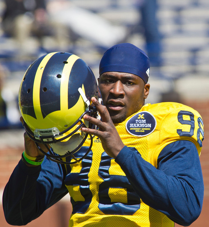 . Michigan quarterback Devin Gardner (98) holds his helmet, during the football team\'s annual spring game, Saturday, April 5, 2014, in Ann Arbor, Mich. (AP Photo/Tony Ding)
