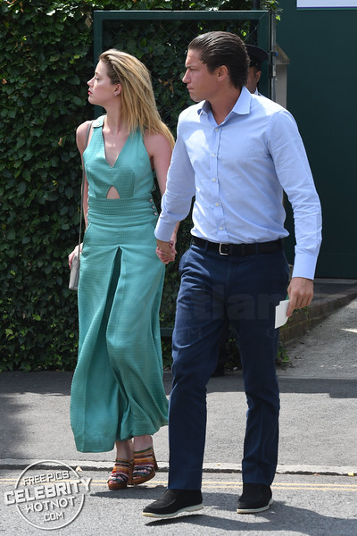 Amber Heard Holds Hands With New Beau Vito Schnabel In Statement Mint Green Jumpsuit