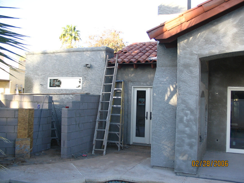 It's all starting to come together. Here you can see the outdoor shower area, the pool deck, the entrance to the bedroom, and the patio and living room sliding glass door.