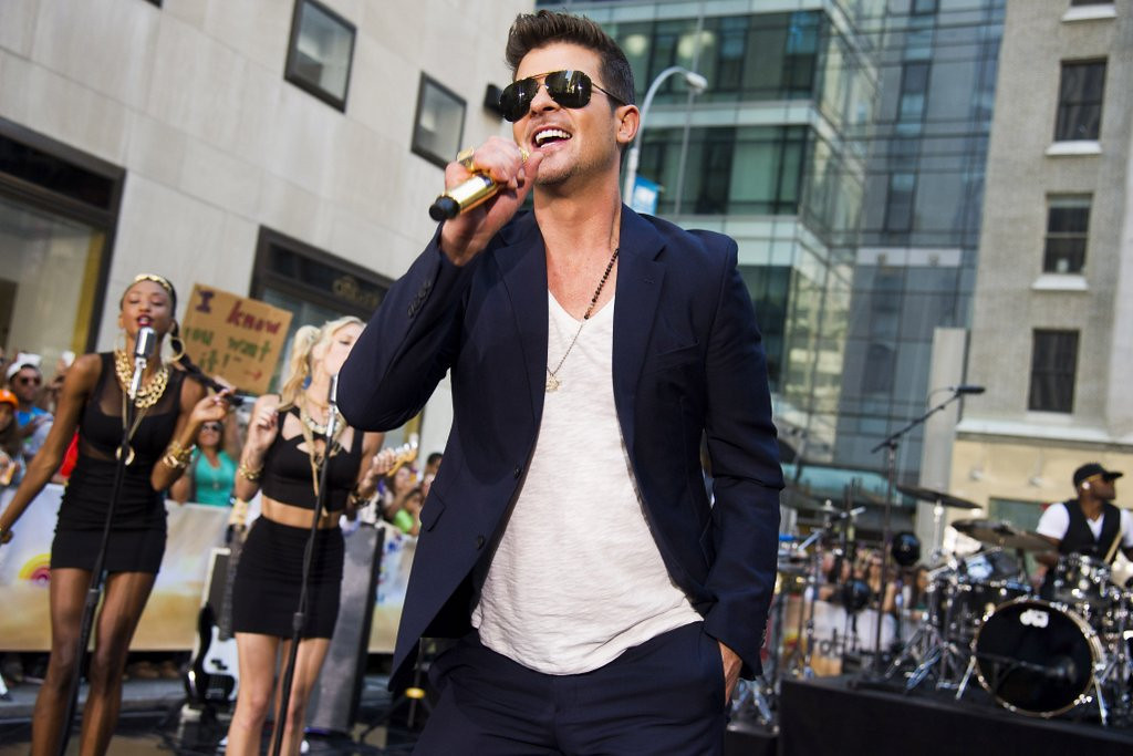 ". <p><b> Pop star Robin Thicke is no doubt red-faced after the publication of a photo that shows him seriously groping � </b> <p> A. A fan  <p> B. Miley Cyrus  <p> C. Himself  <p><b><a href=\'http://www.nypost.com/p/pagesix/robin_thicke_posts_controversial_NrYlktgjz57hMHSxzViU7I\' target=""_blank\"">HUH?</a></b> <p>     (Charles Sykes/Invision/AP, File)  <br>  <p><b>ANSWERS</b> <p> The correct answer is always \""A\"" ... unless you feel very strongly otherwise. <p>  <p>Follow Kevin Cusick on <a href=\'http://twitter.com/theloopnow\'>twitter.com/theloopnow</a>."