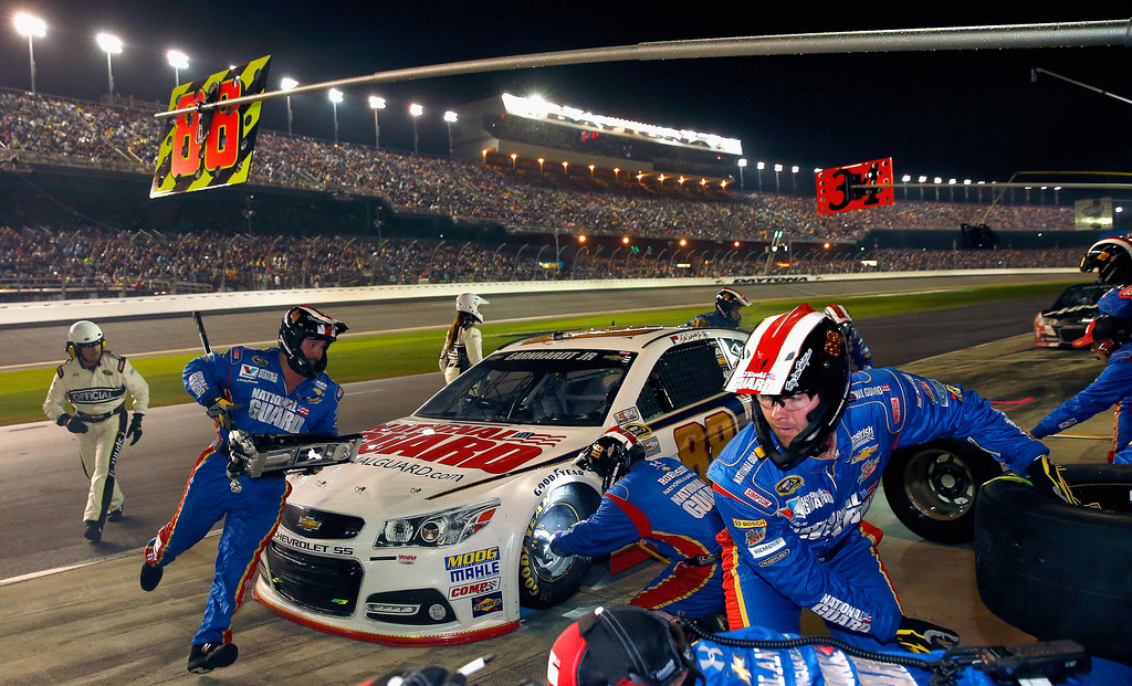 . Dale Earnhardt Jr., driver of the #88 National Guard Chevrolet, pits during the NASCAR Sprint Cup Series Daytona 500 at Daytona International Speedway on February 23, 2014 in Daytona Beach, Florida.  (Photo by Tom Pennington/Getty Images)