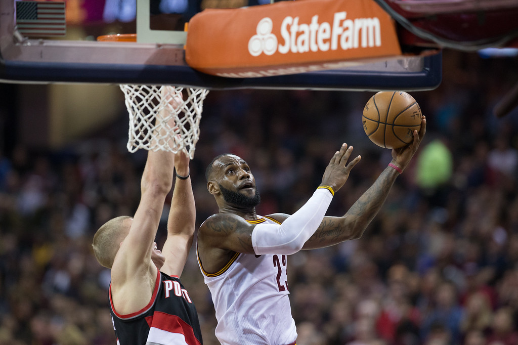 . Michael Johnson - The News-Herald Lebron James of the Cleveland Cavaliers (23) goes up for a layup against Mason Plumlee  during a home game against the Portland Trailblazers on November 23, 2016 at the Quicken Loans Arena.