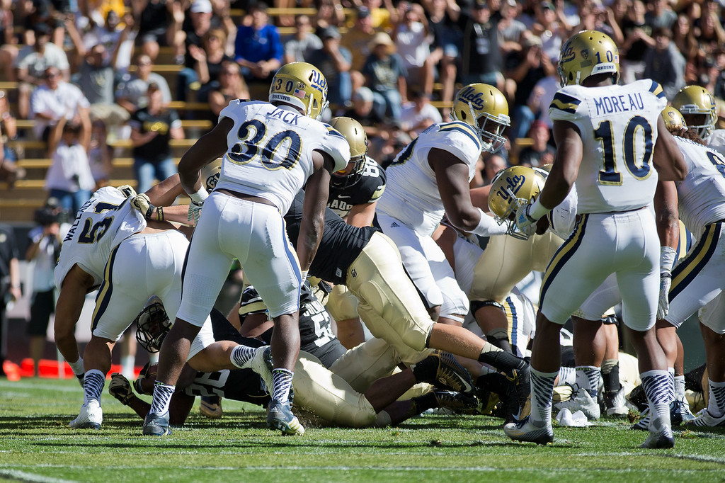 . BOULDER, CO - OCTOBER 25:  Running back Tony Jones #26 of the Colorado Buffaloes dives into the end zone for a touchdown during the second quarter against the UCLA Bruins at Folsom Field on October 25, 2014 in Boulder, Colorado. (Photo by Justin Edmonds/Getty Images)