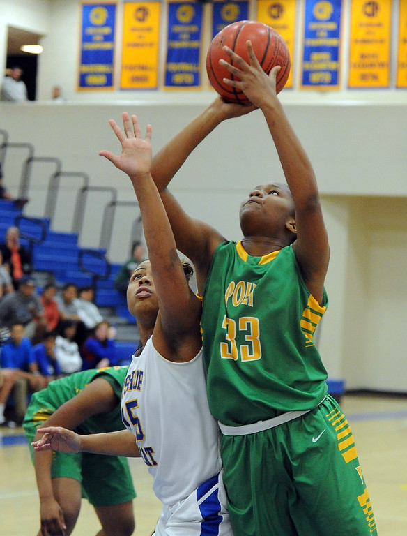 . Long Beach Poly\'s Mahogany Brown (33) drives to the basket past Bishop Amat\'s Leeah Powell (15) in the second half of a CIF State Southern California Regional semifinal basketball game at Bishop Amat High School on Tuesday, March 12, 2013 in La Puente, Calif. Long Beach Poly won 52-34.  (Keith Birmingham Pasadena Star-News)