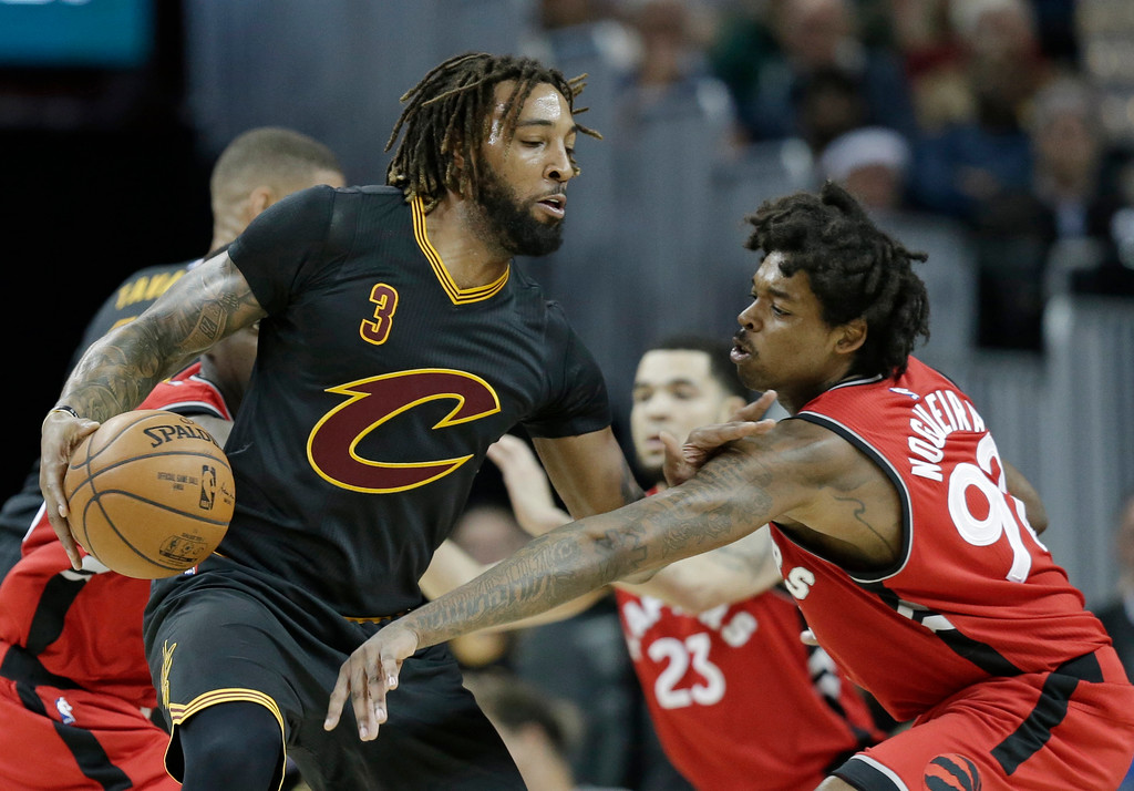 . Cleveland Cavaliers\' Derrick Williams (3) drive past Toronto Raptors\' Lucas Nogueira (92), from Brazil, in the second half of an NBA basketball game, Wednesday, April 12, 2017, in Cleveland. The Raptors won 98-83.(AP Photo/Tony Dejak)