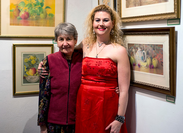 12/06/19 Wesley Bunnell | StaffrrThe Art League of New Britain is holing an exhibit titled Art in the Family A Retrospective by Kenneth Larson (1947-1994) Liz Winchester-Larson and their daughter Sarah Larson. Liz Winchester-Larson , L, poses with daughter Sarah Larson on the opening night exhibit on Friday December 6, 2019.