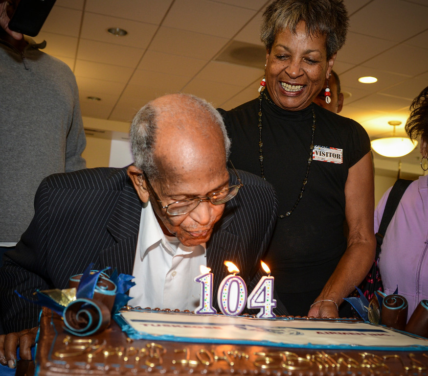 . Walter Crenshaw blows out the candles of his 104th birthday cake Sunday, October 27, 2013.  A surprise 104th birthday celebration was held for the oldest living Tuskegee Airman at the Veterans Home of California in Los Angeles.   ( Photo by David Crane/Los Angeles Daily News )