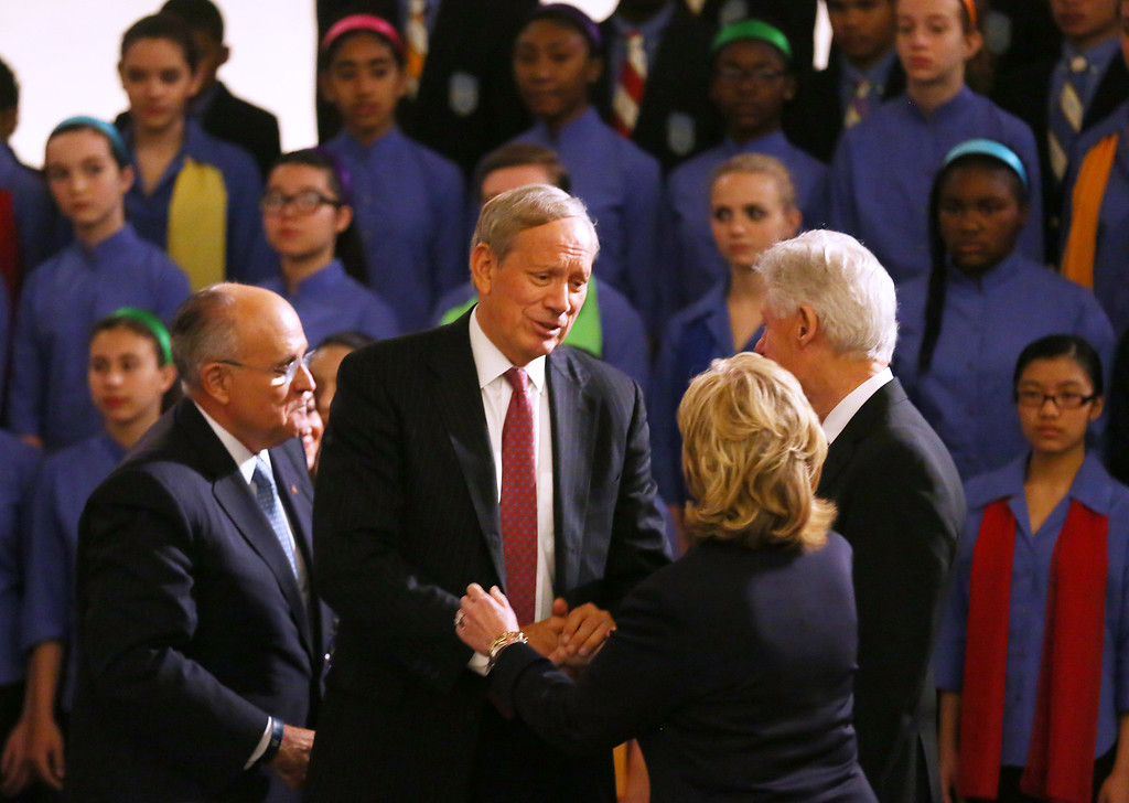. Former New York Governor George Pataki (2nd L), greets former U.S. President Bill Clinton (R) and former US Secretary of State Hillary Rodham Clinton before the dedication ceremony at the National September 11 Memorial Museum May 15, 2014 in New York City.  (Photo by Chang W. Lee-Pool/Getty Images)