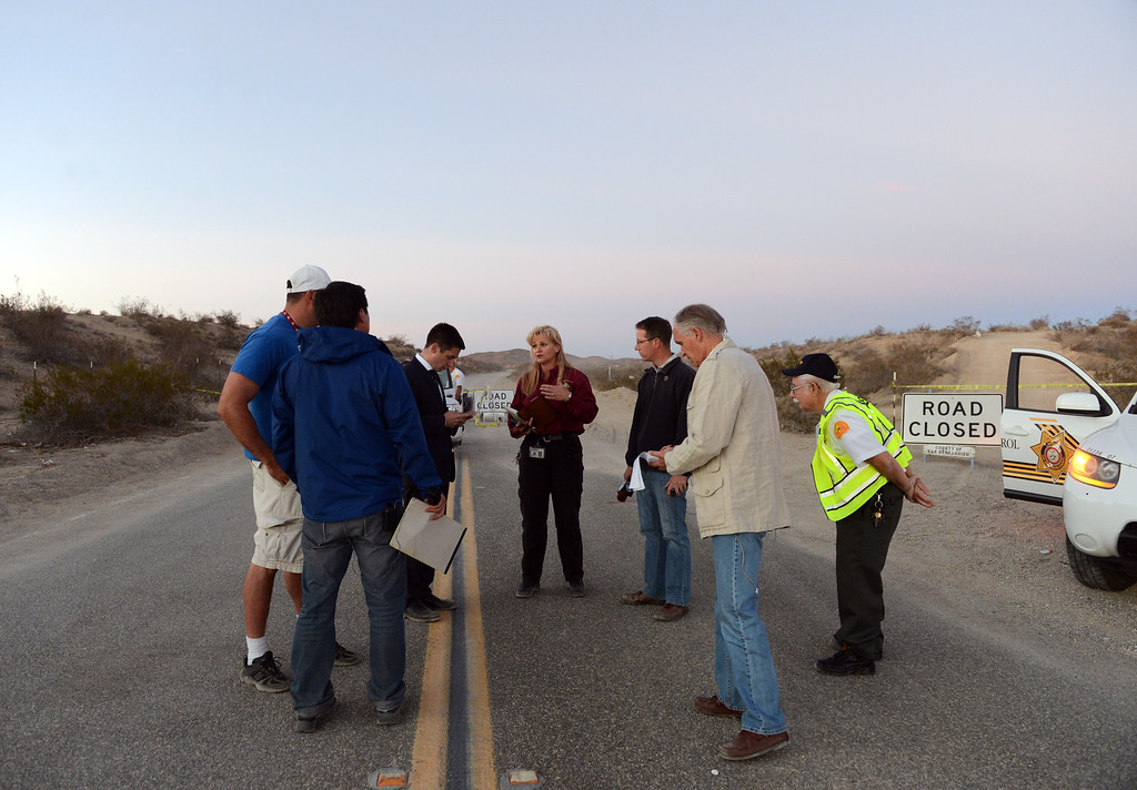 . San Bernardino County sheriff�s spokeswoman Jodi Miller talks with members of the press near the area where the remains of four victims were found buried in two shallow graves in the desert just north of Victorville Wednesday, November 13, 2013. (Photo by Jennifer Cappuccio Maher/Inland Valley Daily Bulletin)