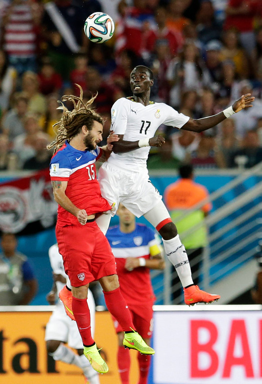 . United States\' Kyle Beckerman, left, goes up against Ghana\'s Mohammed Rabiu for a header during the group G World Cup soccer match between Ghana and the United States at the Arena das Dunas in Natal, Brazil, Monday, June 16, 2014.  (AP Photo/Petr David Josek)