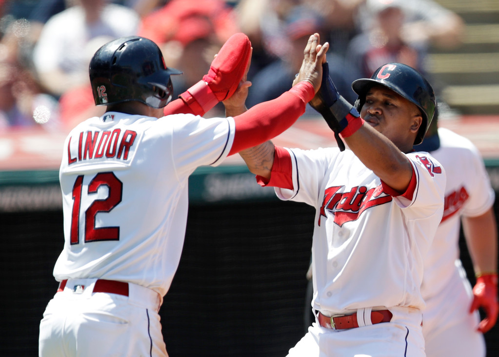 . Cleveland Indians\' Jose Ramirez, right, and Francisco Lindor celebrate after both score in the third inning of a baseball game against the Pittsburgh Pirates, Wednesday, July 25, 2018, in Cleveland. (AP Photo/Tony Dejak)
