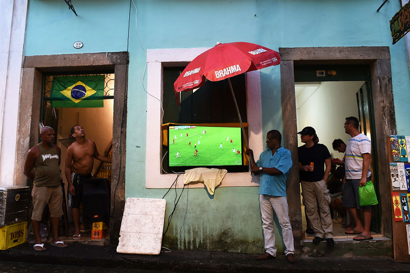 . Brazilian supporters watch a live screening under the rain in Salvador De Bahia on June 18, 2014 during the Group B football match between Spain and Chile in the Maracana Stadium in Rio de Janeiro for the 2014 FIFA World Cup. (ANNE-CHRISTINE POUJOULAT/AFP/Getty Images)