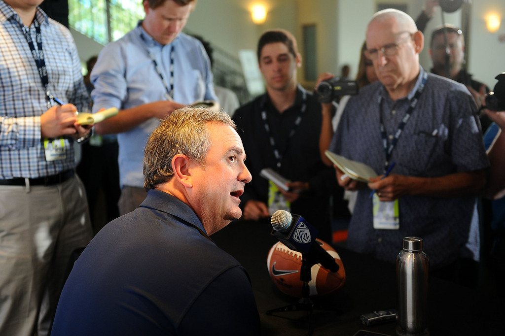 . California head coach Sonny Dykes answers questions during PAC-12 Football Media Day at the Paramount Theater in Los Angeles, Ca July 23, 2014.(Andy Holzman/Los Angeles Daily News)