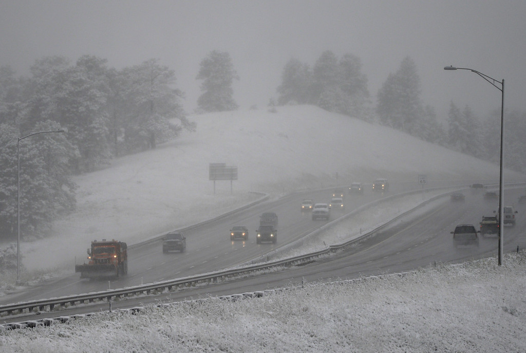 . GENESEE, CO - OCTOBER 04: Winter driving is back in Colorado as traffic makes its way along Interstate 70 near Geness, October 04, 2013. The mountain could see up to a foot of snow from this storm. (Photo By RJ Sangosti/The Denver Post)