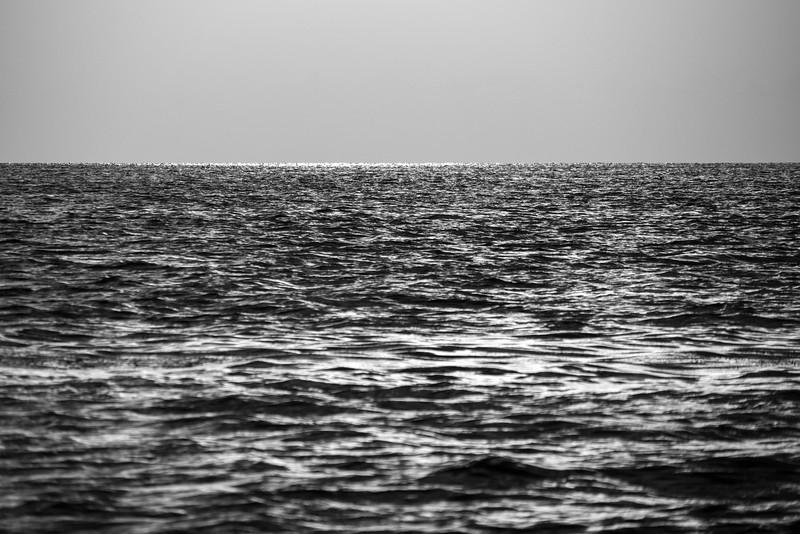 black and white sunset reflection