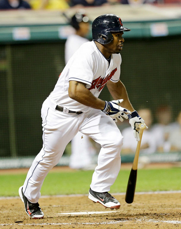 . Cleveland Indians\' Michael Bourn watches his ball after hitting an RBI-single off Detroit Tigers starting pitcher Justin Verlander in the seventh inning of a baseball game, Wednesday, Sept. 3, 2014, in Cleveland. Yan Gomes scored on the play. (AP Photo/Tony Dejak)