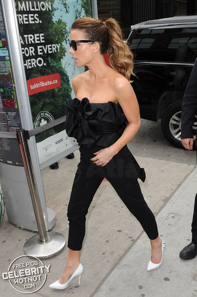 Kate Beckinsale Wears Bustier Jumpsuit & Oversized Sunglasses At TIFF in Canada