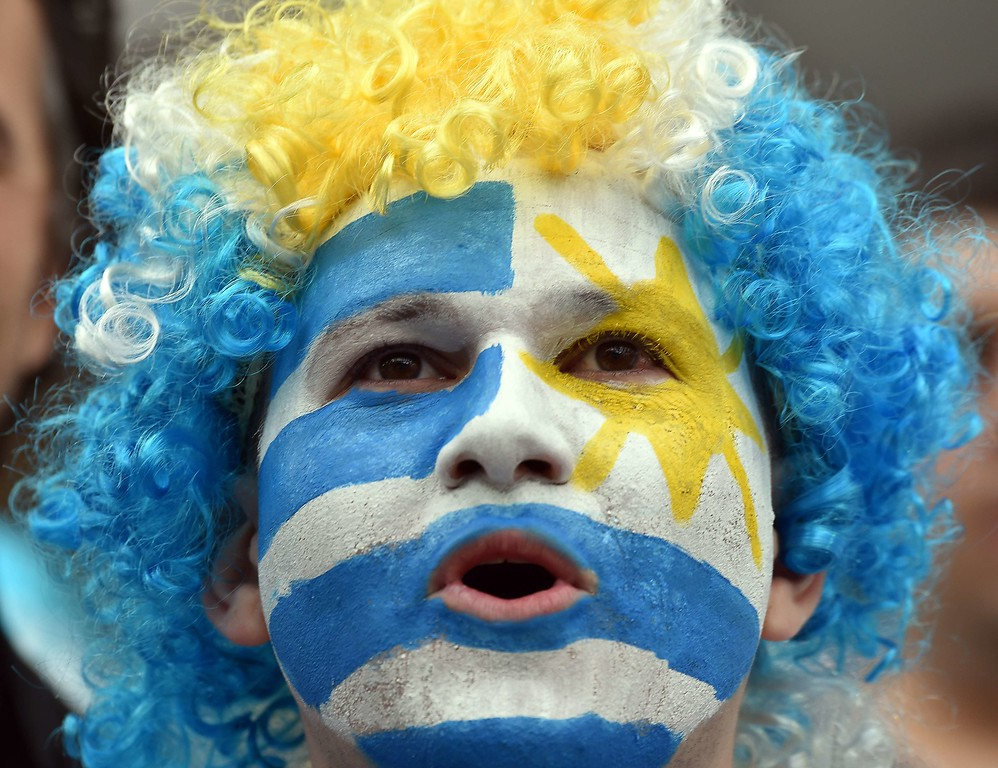 . An Uruguayan fan cheers before the start of a Group D football match between Uruguay and England at the Corinthians Arena in Sao Paulo during the 2014 FIFA World Cup on June 19, 2014.   AFP PHOTO / LUIS  ACOSTA/AFP/Getty Images