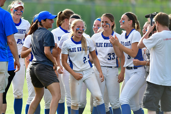 6/8/2019 Mike Orazzi | Staff Southington girls celebrate after a win over NFA during Saturday's Class LL Softball Final at DeLuca Field in Stratford.