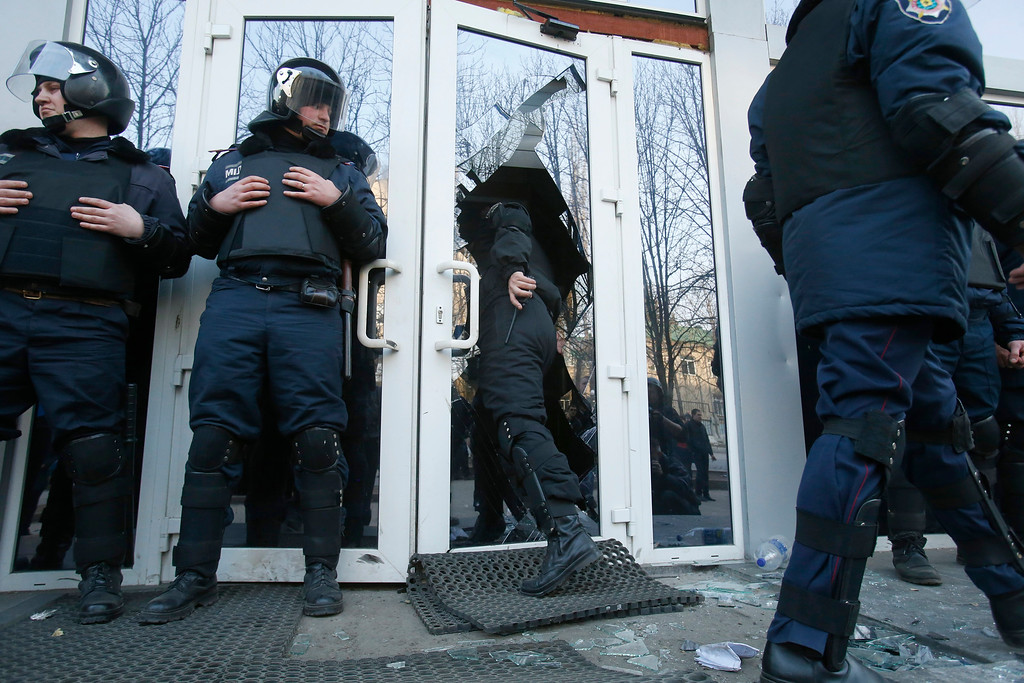 . Police stand guard after Pro Russia protestors stormed the regional governance Security Service of Ukraine building during a rally in Donetsk, Ukraine, Saturday, March 15, 2014. (AP Photo/Sergei Grits)