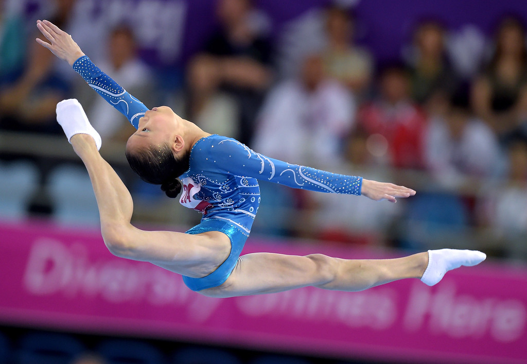. China\'s Shang Chunsong performs her floor routine during the women\'s individual all-round final at the 2014 Asian Games in Incheon on September 23, 2014. PORNCHAI KITTIWONGSAKUL/AFP/Getty Images