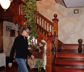 Louie LaLonde leads the way near the stairwell in her home.  Just as was Verda Schneerer, Louie is very active within the community.