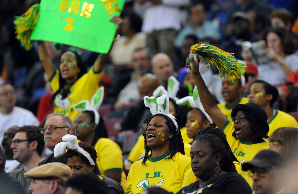 . A small but vocal Poly group of fans cheer on the Jackrabbits at Sleep Train Arena in Sacramento, CA on Saturday, March 29, 2014. Long Beach Poly vs Salesian in the CIF Open Div girls basketball state final. 2nd half. Poly won 70-52. (Photo by Scott Varley, Daily Breeze)