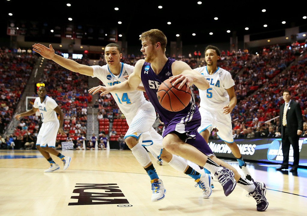 . Thomas Walkup #0 of the Stephen F. Austin Lumberjacks drives against Zach LaVine #14 and Kyle Anderson #5 of the UCLA Bruins in the first half during the third round of the 2014 NCAA Men\'s Basketball Tournament at Viejas Arena on March 23, 2014 in San Diego, California.  (Photo by Jeff Gross/Getty Images)