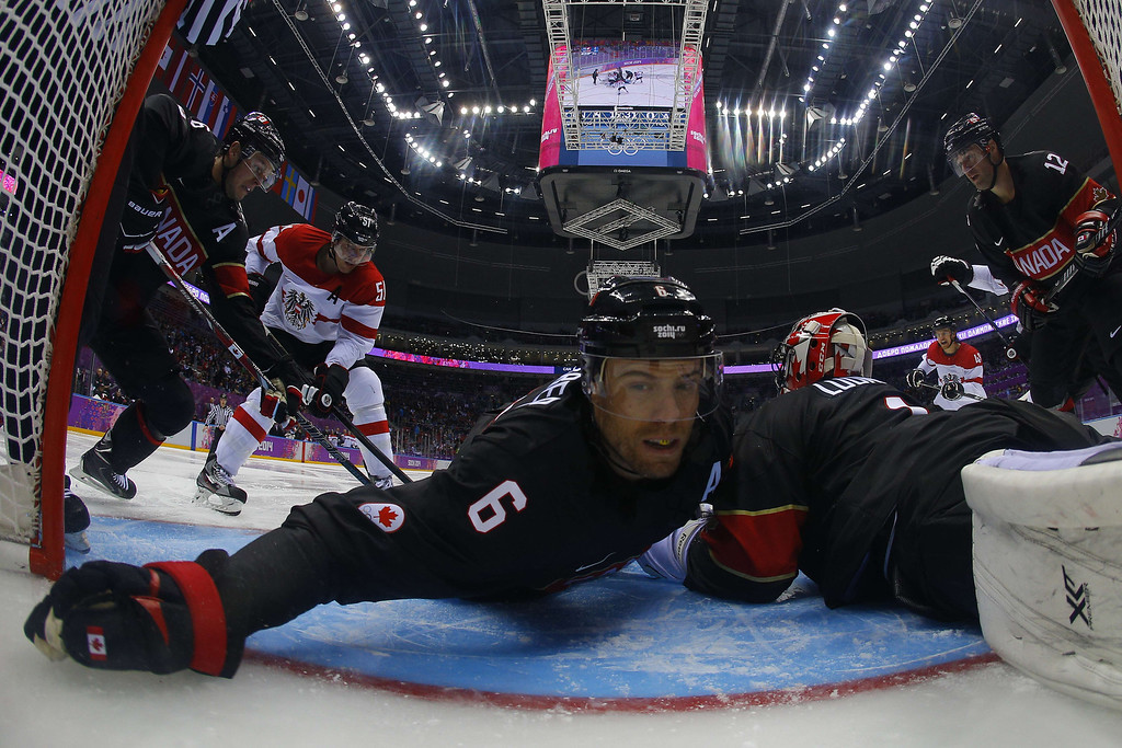 . Canada\'s Shea Weber (C) falls in the net during the Men\'s Ice Hockey Group B match Canada vs Austria at the Bolshoy Arena during the Sochi Winter Olympics on February 14, 2014.  AFP PHOTO POOL / MARK BLINCH/AFP/Getty Images