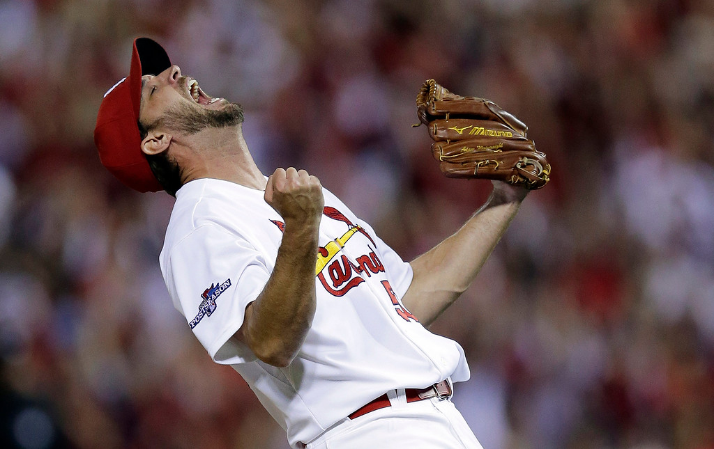 . St. Louis Cardinals pitcher Adam Wainwright celebrates after striking out Pittsburgh Pirates\' Pedro Alvarez for the final out of Game 5 of a National League baseball division series, Wednesday, Oct. 9, 2013, in St. Louis. The Cardinals won 6-1, and advanced to the NL championship series against the Los Angeles Dodgers. (AP Photo/Charlie Riedel)