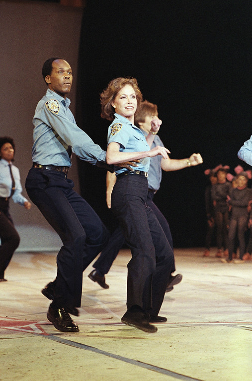 . Mary Tyler Moore performs at the Jacques D?Amboise National Dance Institute benefit, with school children performing original dances at Felt Forum, May 23, 1983. (AP Photo/Mario Suriani)