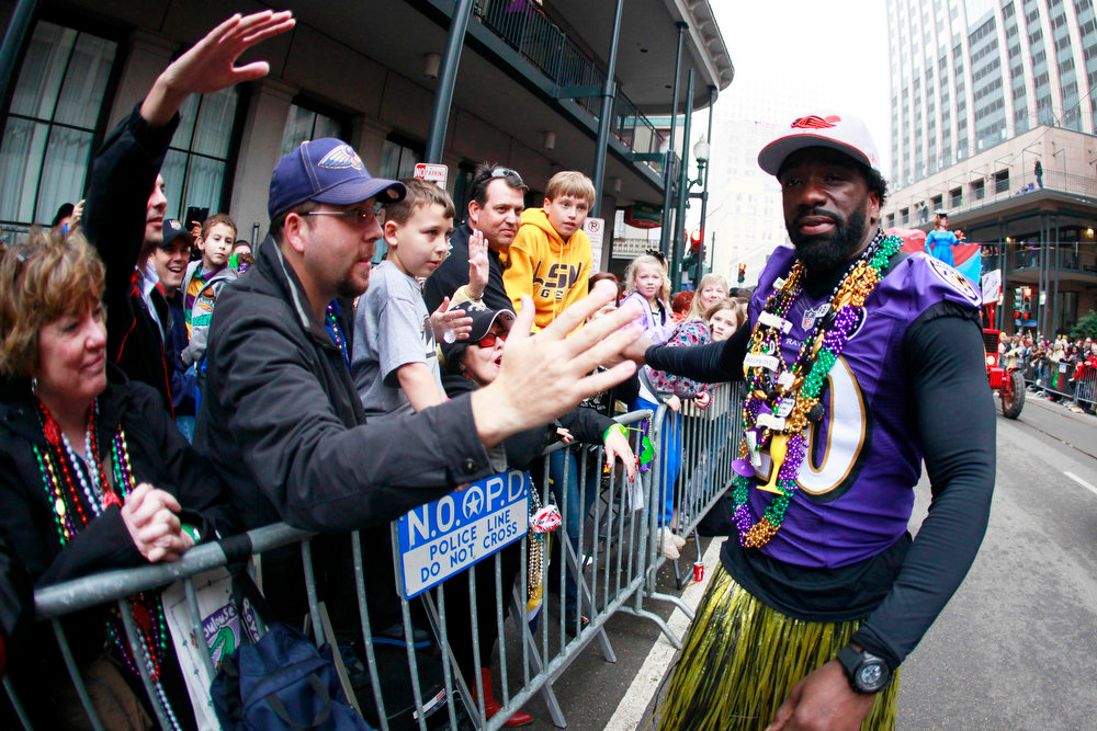 . Super Bowl Champion Baltimore Ravens Ed Reed walks with Members of the Zulu Social Aid and Pleasure Club as they parade down St. Charles Avenue on Mardi Gras Day in New Orleans, Louisiana February 12, 2013. REUTERS/Sean Gardner