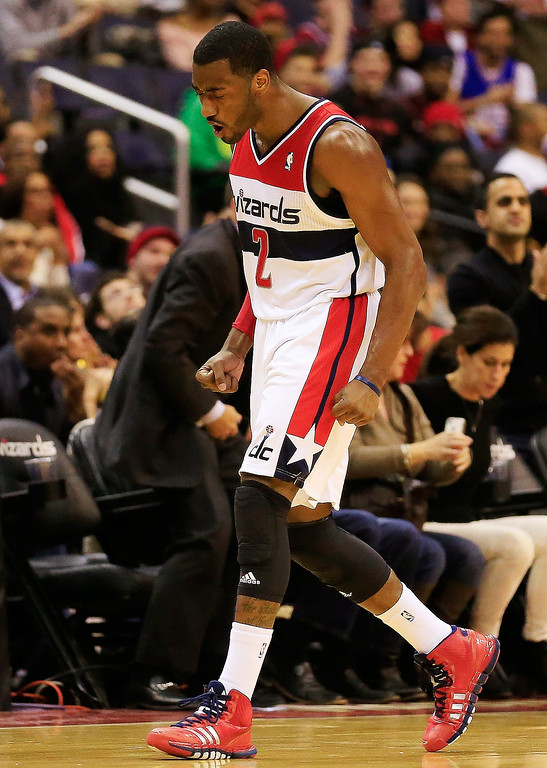 . John Wall #2 of the Washington Wizards celebrates after a timeout was called during the second quarter against the Denver Nuggets  at Verizon Center on December 9, 2013 in Washington, DC.   (Photo by Rob Carr/Getty Images)