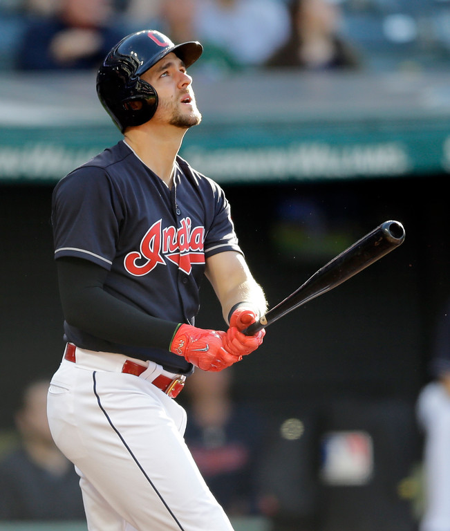 . Cleveland Indians\' Lonnie Chisenhall watches his three-run home run off Tampa Bay Rays starting pitcher Chris Archer in the first inning of a baseball game , Monday, May 15, 2017, in Cleveland. Edwin Encarnacion and Jose Ramirez also scored on the play. (AP Photo/Tony Dejak)