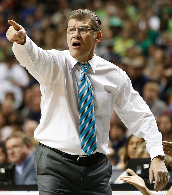 . Connecticut head coach Geno Auriemma watches play against Notre Dame during the second half of the championship game in the Final Four of the NCAA women\'s college basketball tournament, Tuesday, April 8, 2014, in Nashville, Tenn. (AP Photo/John Bazemore)