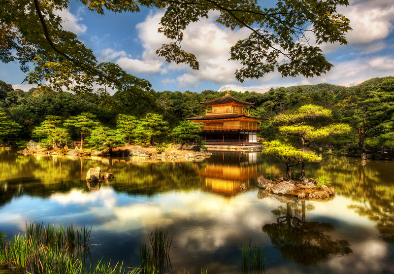 The Golden Pavilion (or Kinkaku-ji for my new Japanese friends)This is one of the most famous temples in Kyoto, so of course I had to go.  It's sort of like going to the Eiffel Tower in Paris or Rudy's BBQ in Austin.It was originally built back in 1397 and has been destroyed and rebuilt several times.  The building itself is as meticulous as the gardens around it.  The Japanese really know how to tend a garden!  There was a fleet of workers all over the grounds, sweeping up and rearranging little bits here and there.  It was all very quaint and wonderful.- Trey RatcliffClick here to read the rest of this post at the Stuck in Customs blog.