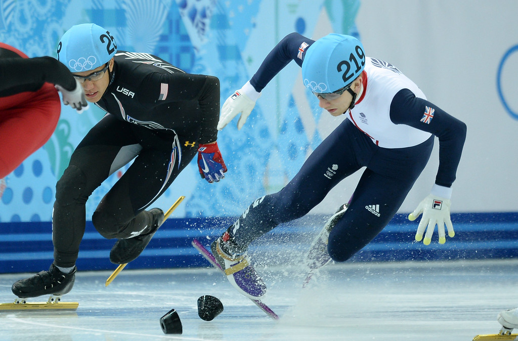 . Great Britain\'s Jack Whelbourne (R) falls as he competes in the Men\'s Short Track 1500 m Final at the Iceberg Skating Palace during the Sochi Winter Olympics on February 10, 2014.        AFP PHOTO / JUNG YEON-JE/AFP/Getty Images